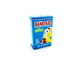 Vintage 1992 Johnson & Johnson BAND-AID Sesame Street Adhesive Bandages Metal Advertising Tin Big Bird Ernie Burt Elmo