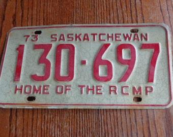 Red on reflective white Vehicle registration plates of Saskatchewan Home of rcmp Vintage 73 Plates Vintage licence plates