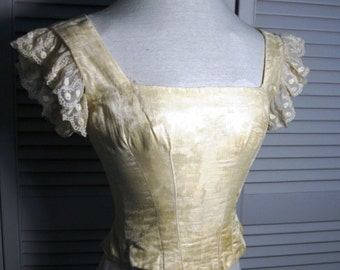 Sale price reduction! Incredibly rare authentic 1880s formal waist of white cotton satin.  Collectible condition.