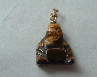Carved tigers eye buddha pendant