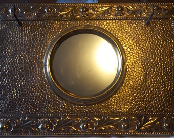 Antique repouse, brass / portal mirror with hooks.