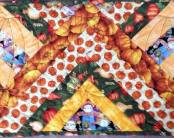 "Autumn Fabrics pieced into this table runner measuring 14.5"" x 28"""