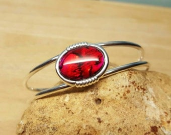 Red Abalone cuff bracelet. Red Paua shell bracelet. Reiki jewelry uk. Silver plated Adjustable bracelet