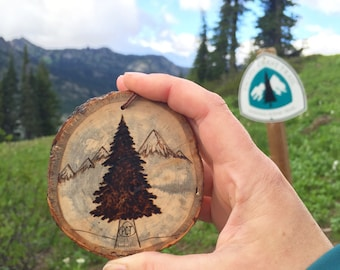 Pacific Crest Trail wood burned pine tree mountain scene ornament. Commemorative hike, rustic wooden branch ornament or wall hanging