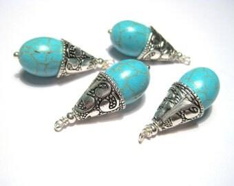 Turquoise Teardrop Gemstone Pendant With Antique Silver Cone Cap