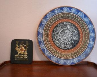 Vintage Aztec plate and Junio Etzalqualiztli Aztec Plaque