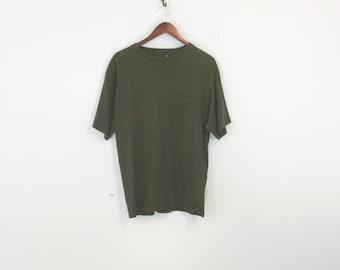 90's pocket t shirt, basic box cut green, t shirt size medium, made in usa.