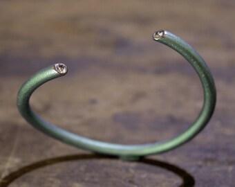 Anodized titanium bracelet with diamonds
