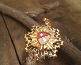 vintage gold tone two tiered eight sided emblem pendant