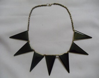 Black Trendy necklace with gold toned chain