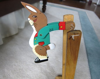 Vintage antique reproduction of classic wooden jumping rabbit toy from 1990, in new condition