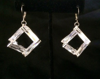 Diamond Like Long Faceted Cubic Zirconia Rectangles Layered On Top Of Each Other In A Square Shape In Silver Metal