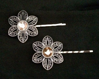 Set Of 2 Silver Metal Flower Hair Pins With Pink/Peach Colored Stones