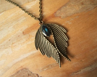 Cloaked Wings necklace. Hand finished deep blue 'eye'.  Goth necklace