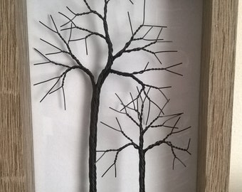 Small twisted wire tree in a rustic frame.