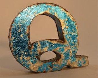 A fantastic vintage style metal 3D blue letter Q