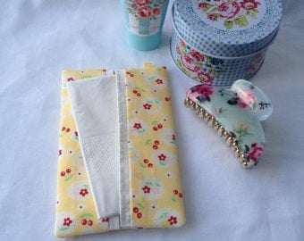 Fabric pocket tissue holder, a travel tissue cover in pretty yellow fabric.