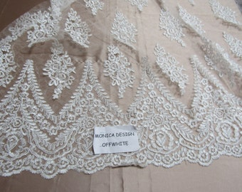 Magnificent French design bridal wedding embroider fabric mesh lace off white. Sold by yard.