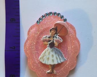 Tightrope walker on pink cameo brooch