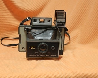 """420 polaroid camera with flash attachment and flash cubes """"priced to move"""""""