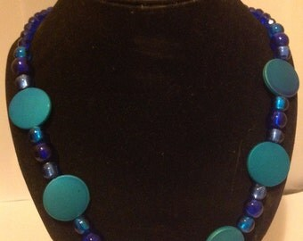 Turquoise discs with blue glass foil beads.