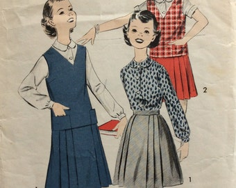 CLEARANCE!!  Advance 8719 girls blouse, pleated skirt and vest  size 8 vintage 1950's sewing pattern
