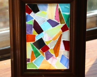 Glass mosaic picture in frame.