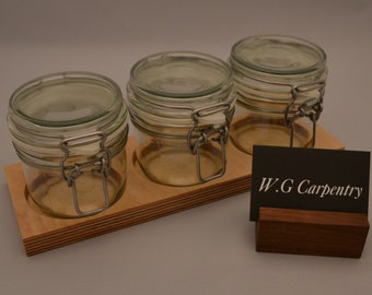 Small glass canisters with wooden stand