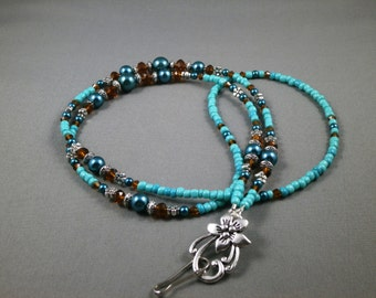 """Cute breakaway lanyard necklace with flower charm for ID holder or eyeglasses 30"""" to 42"""" with magnetic ,toggle or no clasp.unique cute"""