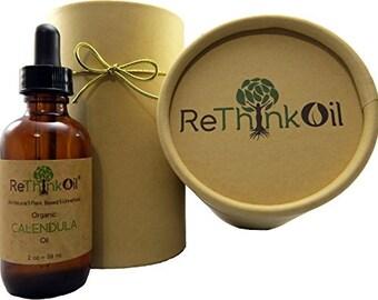 2 oz Organic Calendula -Jojoba oil infusion (glass bottle with dropper top and ECO tube)