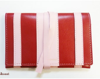 Tobacco leather red and pink, closure strap pouch.
