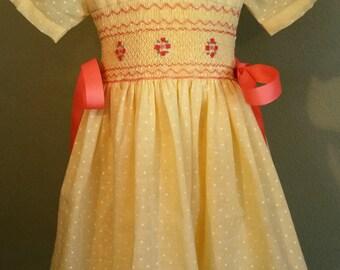 Smocked yellow with orange dress size 4