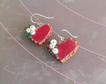 Polymer clay heart cookie earrings.