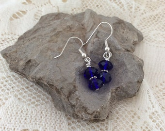 Cobalt blue earrings with rondelles and antique Bali daisy spacers