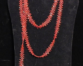 Lacy red beaded flapper necklace or sautoir