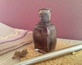 Purple glass bottle ink well antique inkwell
