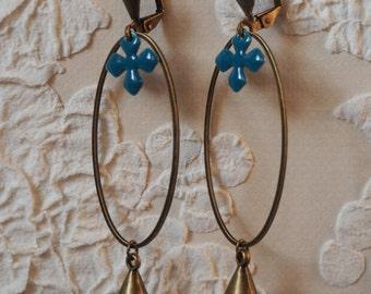 Oval earrings and Blue Cross