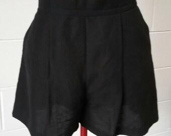 Tailored silk/ linen pleated shorts.