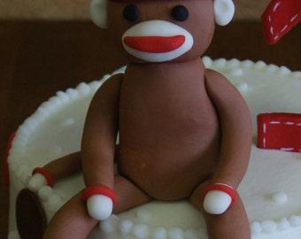 Sock monkey edible cake topper
