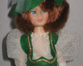 Mamie, 11 inch fashion doll dressed in green gingham gown.