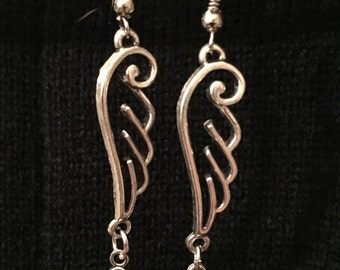 Silver winged with key earrings