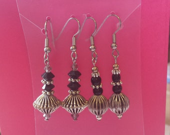 Black and silver (cone shaped and circlular) dangle earrings