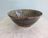 Medium stoneware serving bowl | Black and tan ceramic bowl