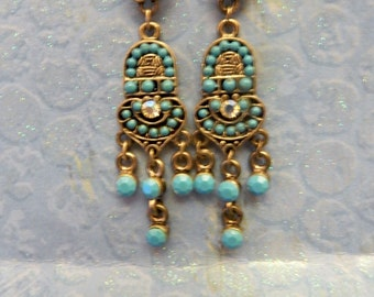 Turquoise colored drop-leaf bead earrings.