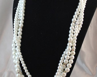 White Swarovski pearl triple braided necklace with Swarovski rondelles with back drop in silver in 6 and 8 mm pearls.