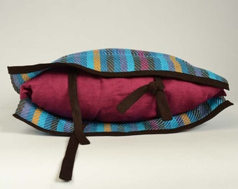 Handwoven cushion of linen. Weaving many-coloured and raspberry. One of a kind and original weaving.