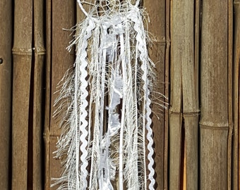 Beautiful white dream catcher with dragonfly