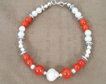 Pearls and Orange beads bracelet