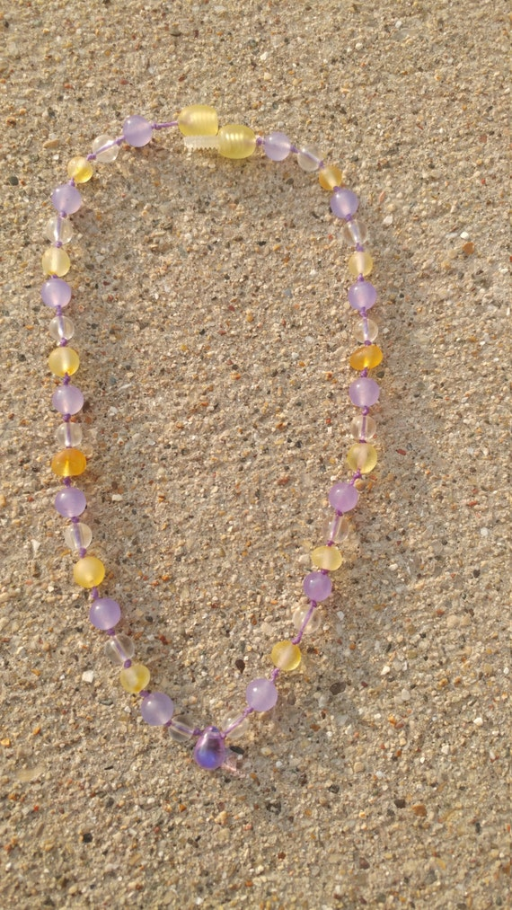 Raw Baltic Amber and Purple Quartzite Necklace with Purple Sea Glass Teardrop. Individually knotted on purple string with a screw clasp.
