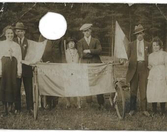 Defaced vernacular real photo postcard.  Vintage snapshot.  Mans face removed